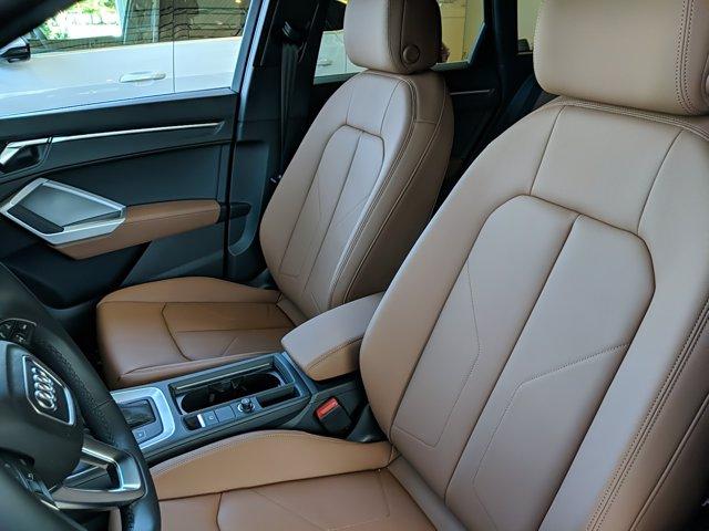 The interior view of Audi Q3 2021 Premium.